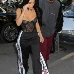 view post Kim and Kourtney Kardashian with Kanye West arriving at Givenchy – Paris